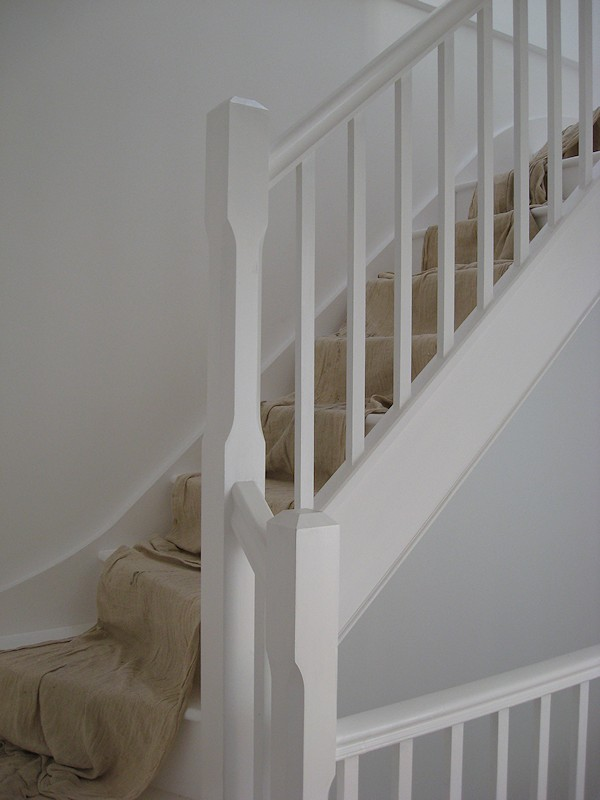 A painted softwood single turn three winder staircase for a loft conversion.