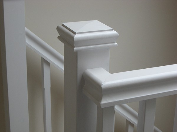 A single turn softwood three winder staircase with a bullnose bottom tread.