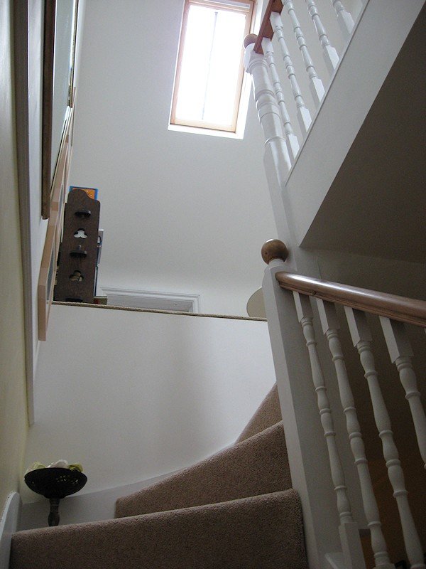 This softwood staircase for a loft conversion has a total of nine winders turning three times over 270 degrees.