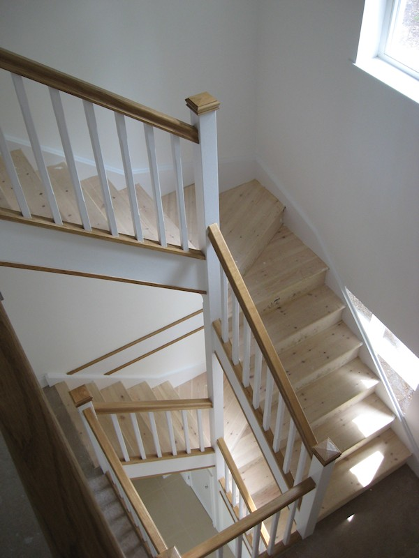 Two winder flights positioned above one another, accessing three floors to this new build large detached family home.