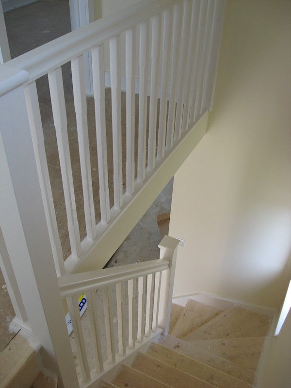 The balustrade comprises of our std handrail, stop chamfer 32mm spindles and flat with rounded edge newel caps.