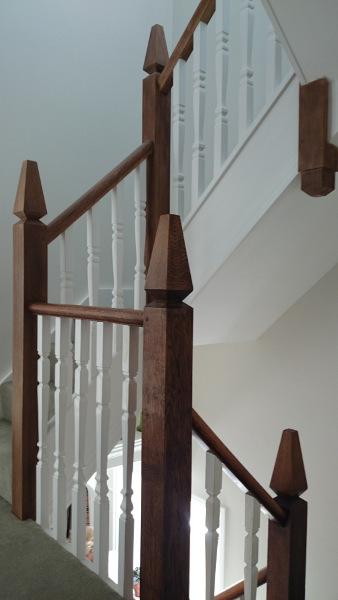 A very unique staircase, just look at those newel tops!