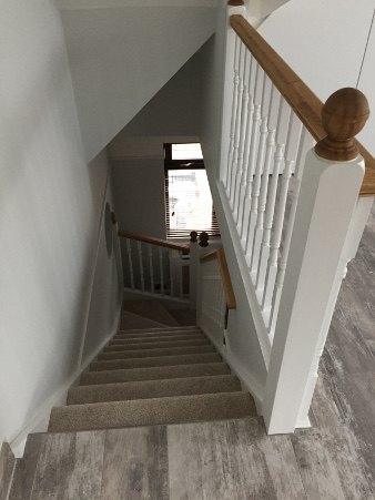 Loft conversion winder staircase using Georgian turned spindles.