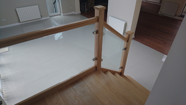 Small oak construction staircase with glass infill panels.