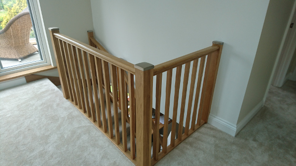 Oak winder staircase using our crown profile handrail.