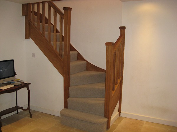 An oak double winder staircase for a farmhouse refurbishment.